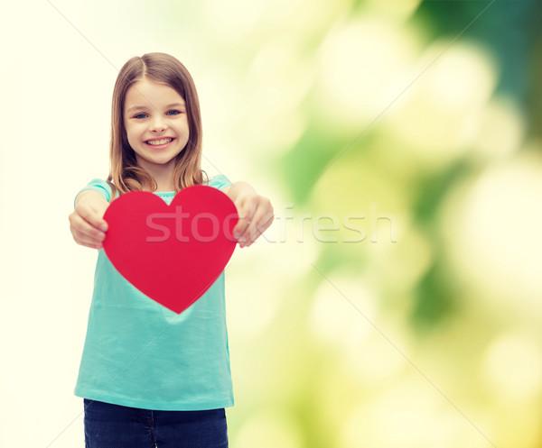 Sonriendo nina rojo corazón amor felicidad Foto stock © dolgachov