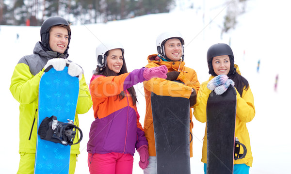 happy friends in helmets with snowboards Stock photo © dolgachov
