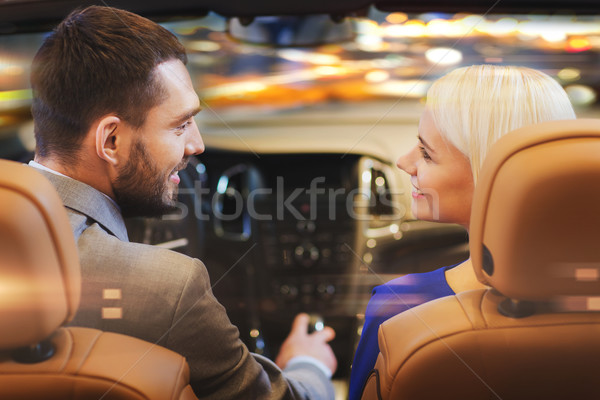 happy couple driving in car over night city  Stock photo © dolgachov