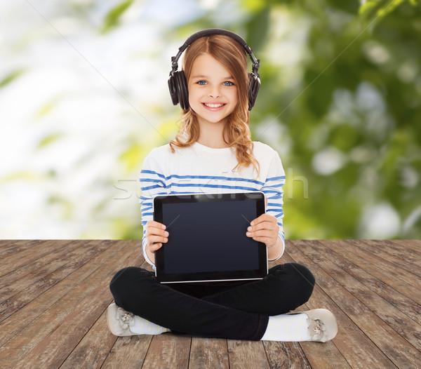 счастливая девушка наушники музыку технологий Сток-фото © dolgachov