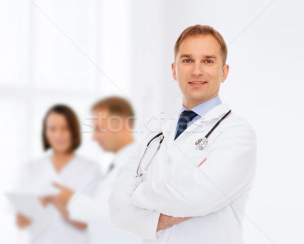笑みを浮かべて 男性医師 聴診器 医療 職業 チームワーク ストックフォト © dolgachov