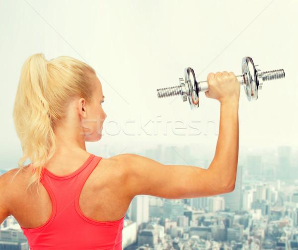 Mulher pesado aço de volta Foto stock © dolgachov