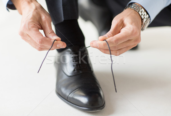 close up of man leg and hands tying shoe laces Stock photo © dolgachov
