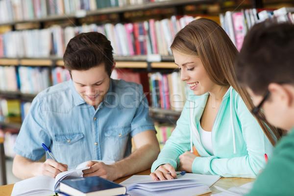 Studentów książek egzamin biblioteki ludzi wiedzy Zdjęcia stock © dolgachov