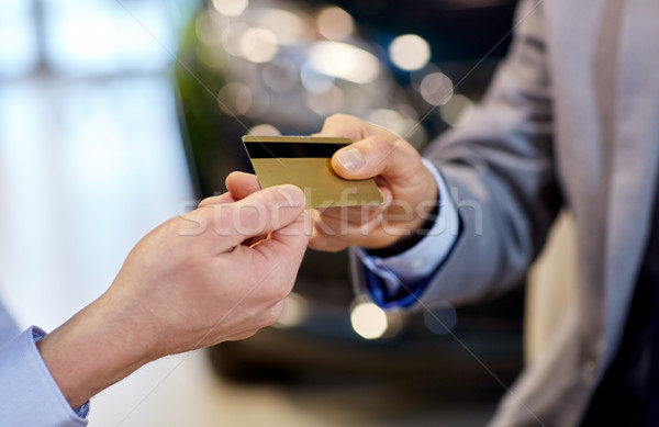 customer giving credit card to car dealer in salon Stock photo © dolgachov