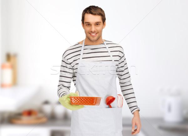 Feliz homem cozinhar utensílios de cozinha pessoas Foto stock © dolgachov