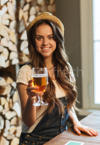 happy young woman drinking water at bar or pub Stock photo © dolgachov