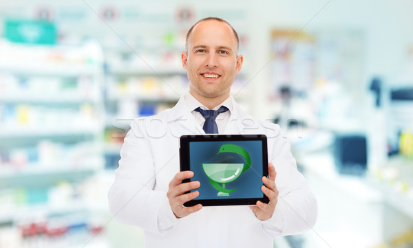 smiling male doctor with tablet pc at drugstore Stock photo © dolgachov