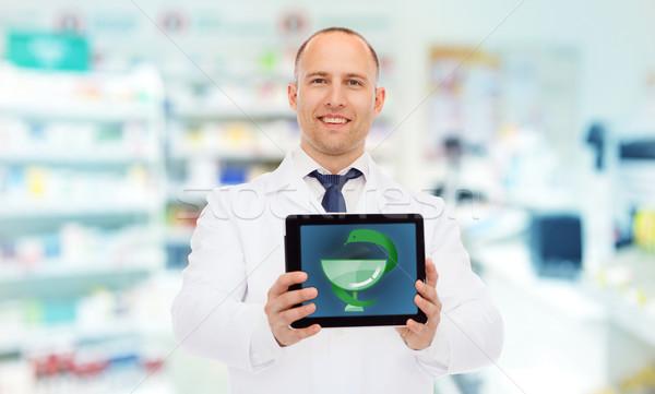 Uśmiechnięty mężczyzna lekarz apteka muzyka apteki Zdjęcia stock © dolgachov