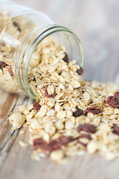 close up of jar with granola or muesli on table Stock photo © dolgachov