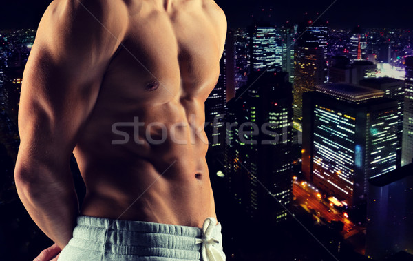 close up of male bodybuilder bare torso Stock photo © dolgachov