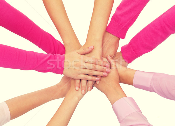 close up of women with hands on top Stock photo © dolgachov