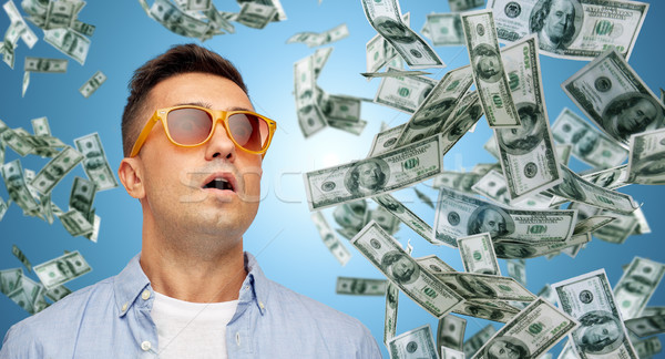 surprised man under dollar money rain Stock photo © dolgachov