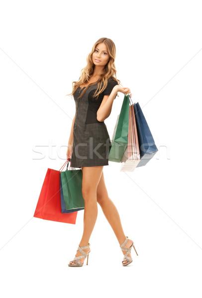 Vásárló nő bevásárlótáskák fehér boldog női Stock fotó © dolgachov