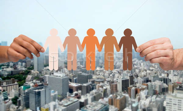 hands with people pictogram over city background Stock photo © dolgachov