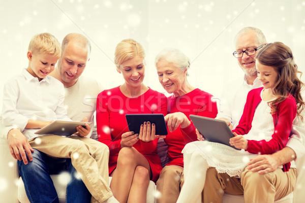 Mosolyog család táblagép számítógépek otthon ünnepek Stock fotó © dolgachov
