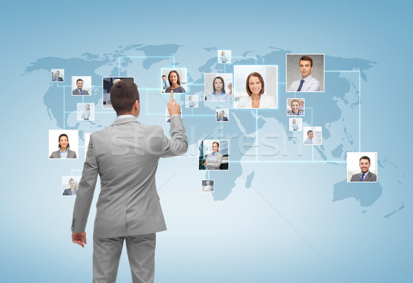 businessman pointing finger to contact icons Stock photo © dolgachov