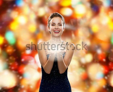sexy woman in red dress over night lights Stock photo © dolgachov