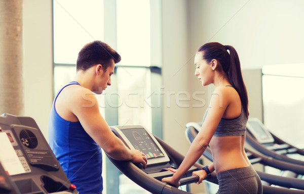 woman with trainer on treadmill in gym Stock photo © dolgachov