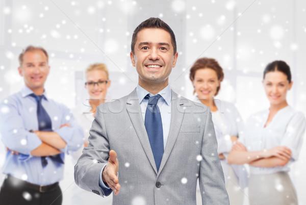 Feliz sonriendo empresario traje gente de negocios Foto stock © dolgachov