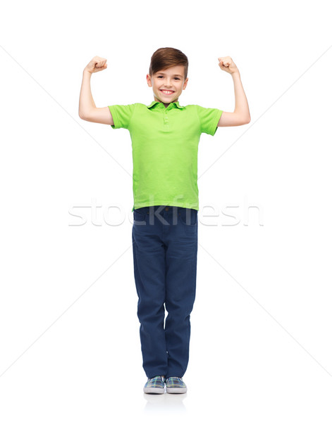 happy boy in polo t-shirt showing strong fists Stock photo © dolgachov