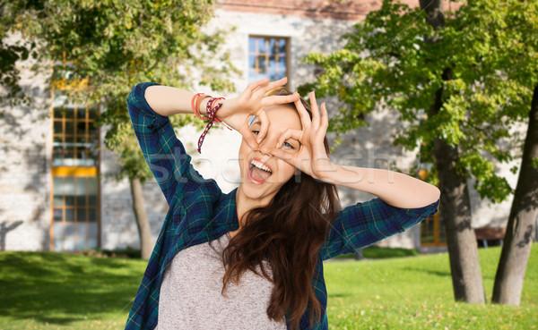 happy student girl making face and having fun Stock photo © dolgachov