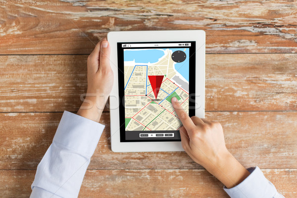close up of hands with navigator map on tablet pc Stock photo © dolgachov