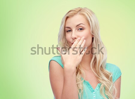 Stock photo: smiling young woman or teen girl covering mouth