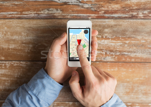 close up of male hands with smartphone on table Stock photo © dolgachov
