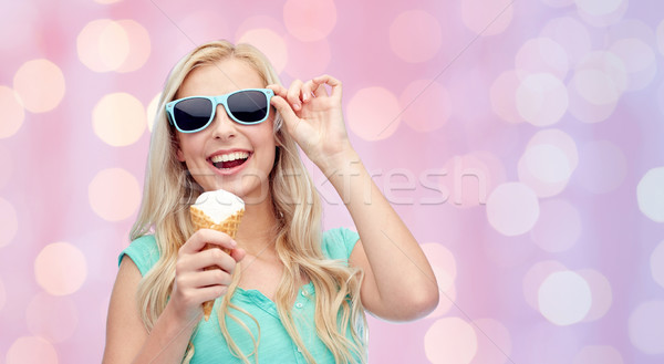 happy young woman in sunglasses eating ice cream Stock photo © dolgachov