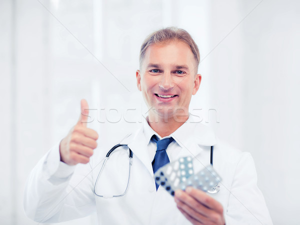 male doctor with packs of pills Stock photo © dolgachov