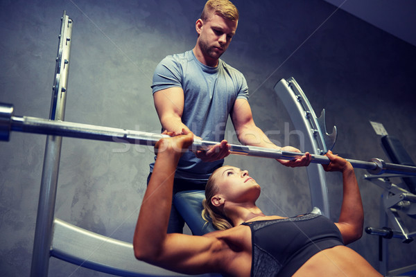 Homme femme barbell muscles gymnase sport Photo stock © dolgachov
