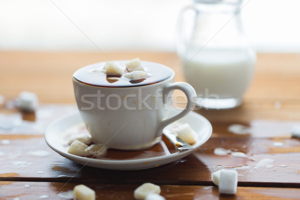 close up of sugar in coffee cup on wooden table Stock photo © dolgachov