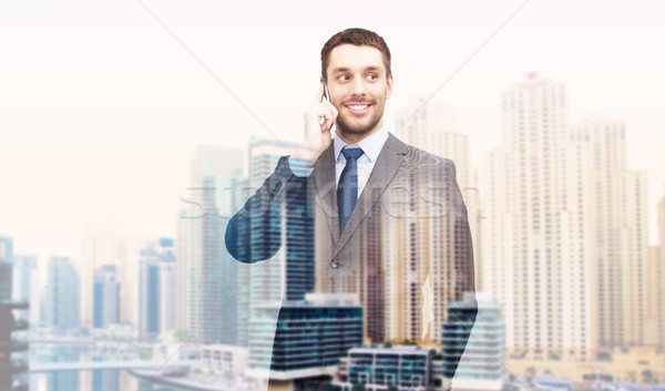 young smiling businessman calling on smartphone Stock photo © dolgachov