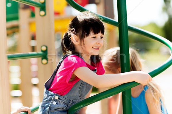 group of happy little girls on children playground Stock photo © dolgachov