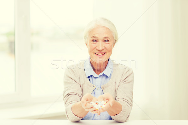happy senior woman with medicine at home Stock photo © dolgachov