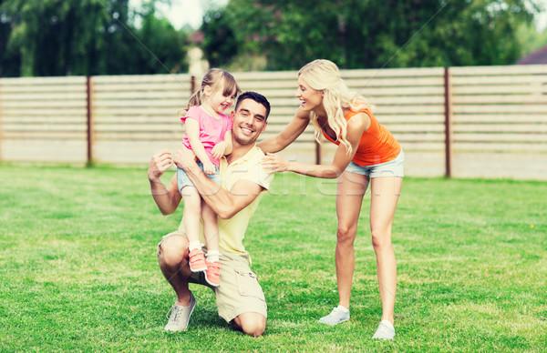Gelukkig gezin buitenshuis familie geluk adoptie Stockfoto © dolgachov