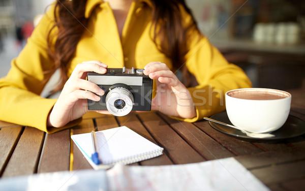 close up of woman with camera at city cafe Stock photo © dolgachov