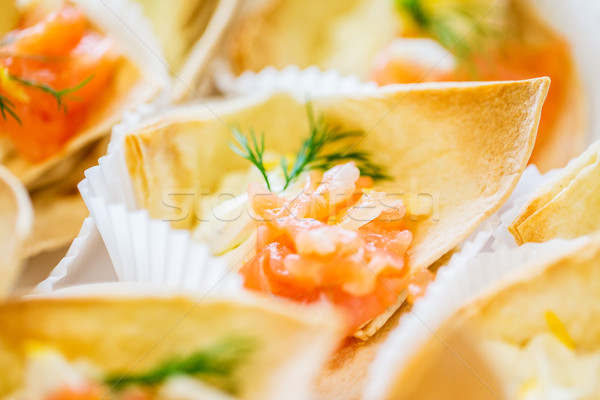 close up of dough cornet with salmon fish filling Stock photo © dolgachov