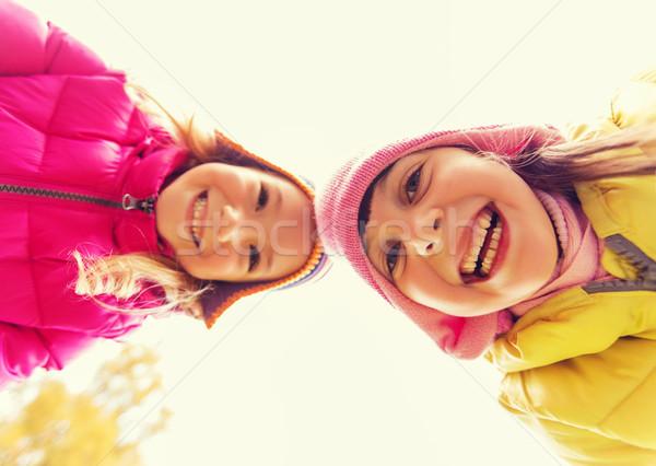 happy girls faces outdoors Stock photo © dolgachov
