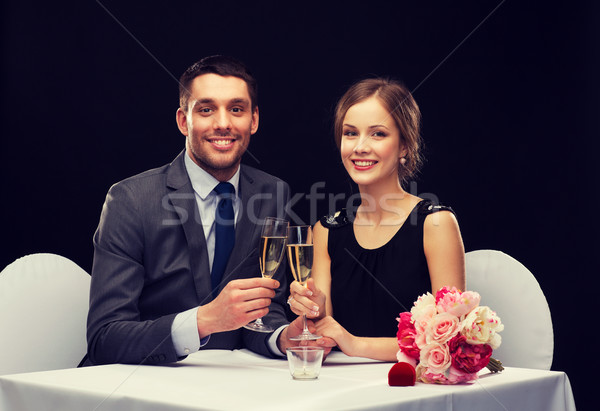 Stock photo: couple with glasses of champagne at restaurant
