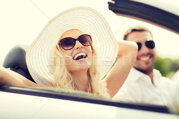 happy man and woman driving in cabriolet car Stock photo © dolgachov