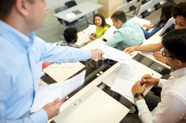teacher giving tests to students at lecture hall Stock photo © dolgachov