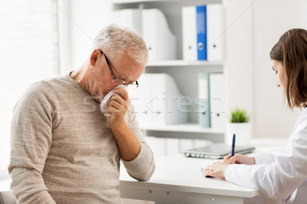 senior man and doctor meeting at hospital Stock photo © dolgachov