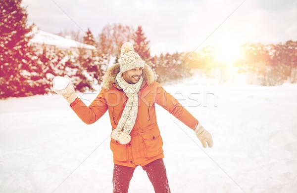 Mutlu genç oynama kış insanlar sezon Stok fotoğraf © dolgachov