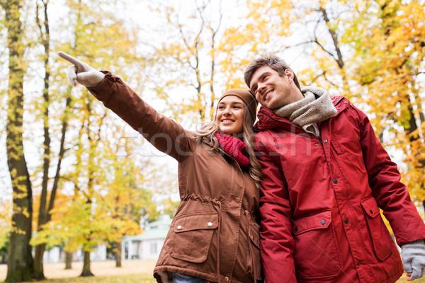 happy young couple walking in autumn park Stock photo © dolgachov