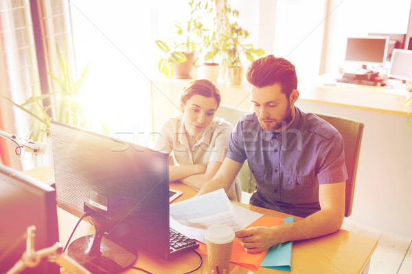 creative team with computer and papers in office Stock photo © dolgachov