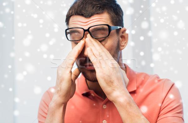 Fáradt férfi szemüveg szemek otthon emberek Stock fotó © dolgachov