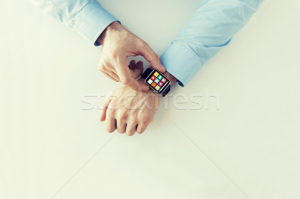 hands with application icons on smart watch Stock photo © dolgachov