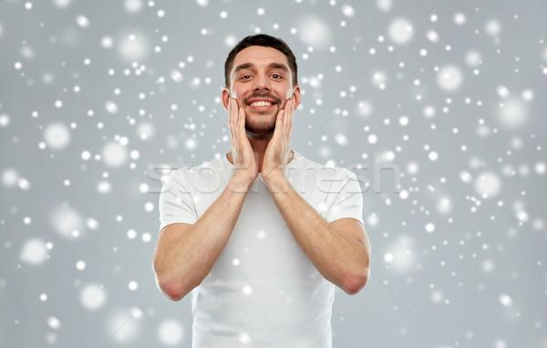Gelukkig man aftershave room gezicht Stockfoto © dolgachov